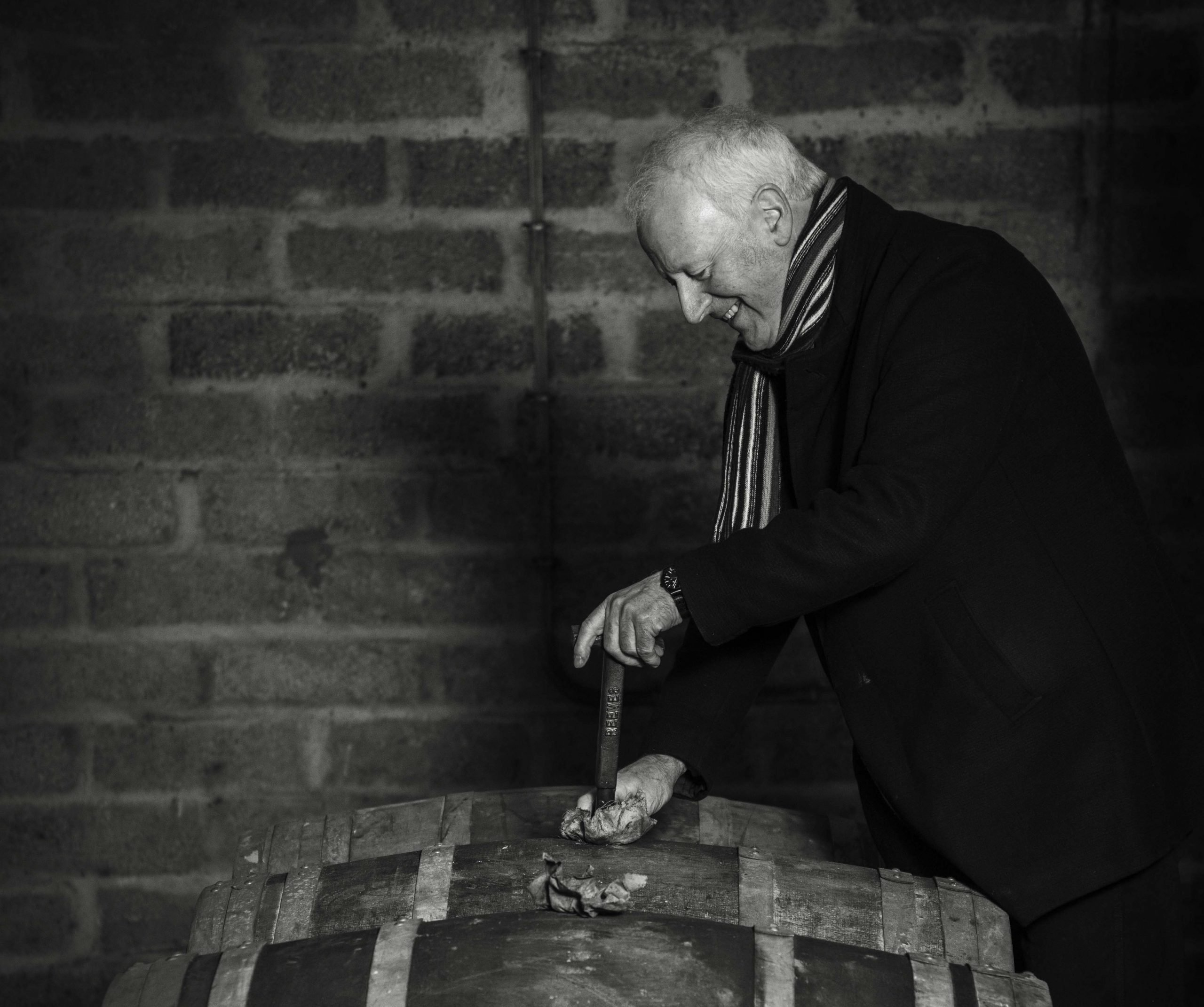 Billy Walker drawing a sample in the GlenAllachie warehouse